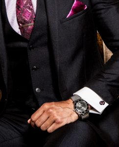 navy suit with breitling watch