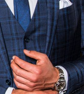 blue check suit with Rolex watch